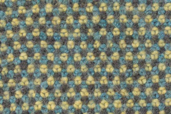 So sieht das Webstrickmuster nach dem Filzen aus.